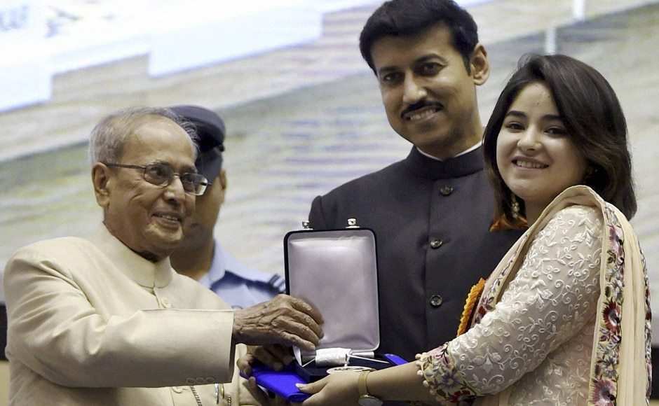Pranab Mukherjee and Rajyavardhan Singh Rathore present Best Supporting Actress Award to Zaira Wasim for Dangal. PTI