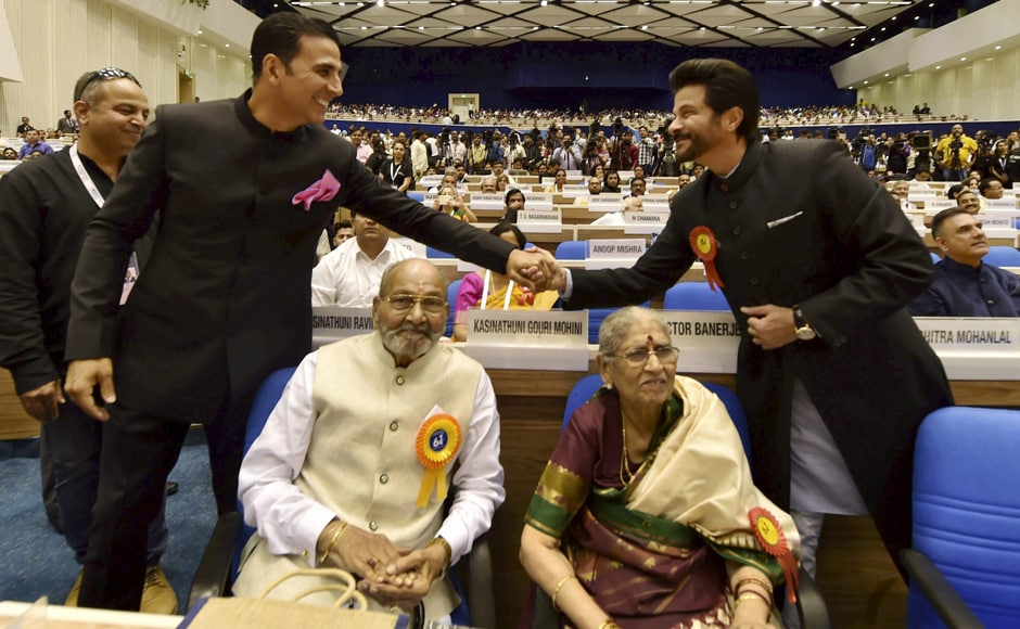 Best Actor Award winner Akshay Kumar and Anil Kapoor exchange greetings behind Dadasaheb Phalke award winner K Vishwanath. PTI