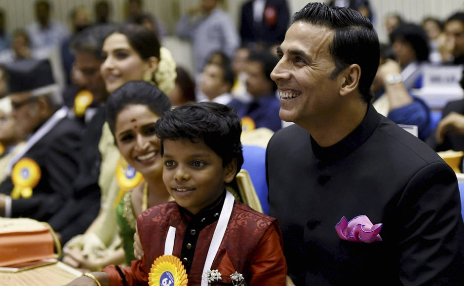 Best Actress Award winner Surabhi CM, child actor Adish Praveen and Akshay Kumar. PTI