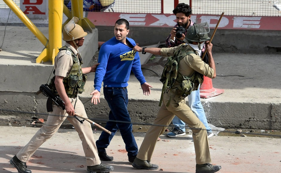 A clash broke out between students and law enforcing agencies outside Women's College in Srinagar on Tuesday against alleged highhandedness of the police. PTI