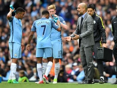 Manchester City's Pep Guardiola (R) speaks to his players during a Premier League match. AFP