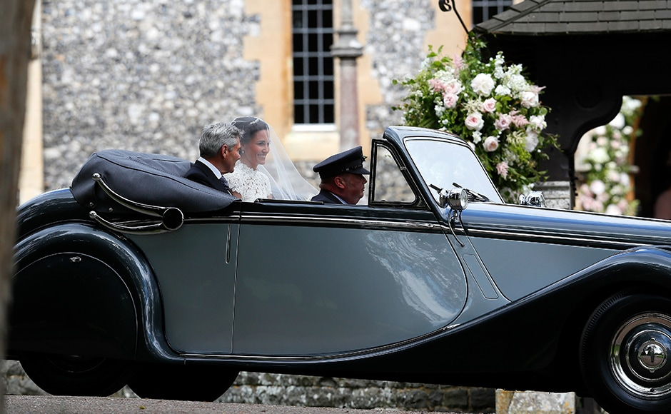 Pippa Middleton arrives with her father Michael Middleton for her wedding to James Matthews at St Mark's Church in Englefield, England Saturday, May 20, 2017. Middleton, the sister of Kate, Duchess of Cambridge is to marry hedge fund manager James Matthews in a ceremony Saturday where her niece and nephew Prince George and Princess Charlotte are in the wedding party, along with sister Kate and princes Harry and William. AP