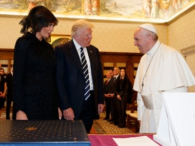 US President Donald Trump and First Lady Melania meet Pope Francis. AP