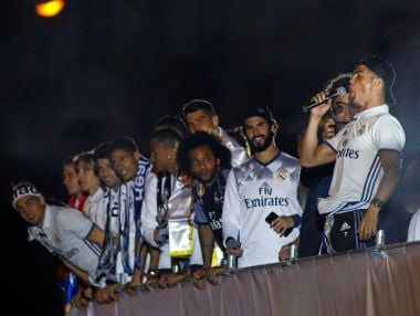 Real Madrid's Cristiano Ronaldo (R) celebrates atop an open bus with his teammates on Sunday. AFP