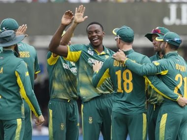South Africa's bowler Kagiso Rabada, centre, celebrates taking the wicket of England's Adil Rashid during the third One Day International cricket match between England and South Africa at Lord's cricket ground in London, Monday, May 29, 2017. (AP Photo/Kirsty Wigglesworth)