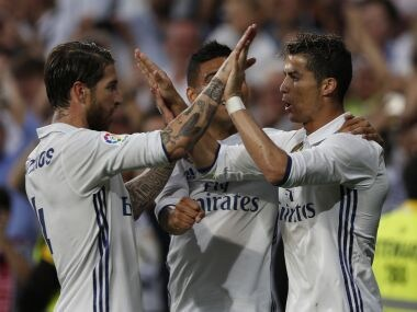 Real Madrid's Cristiano Ronaldo, right, celebrates with teammate Sergio Ramos, left, after scoring their side's third goal against Sevilla during the La Liga soccer match between Real Madrid and Sevilla at the Santiago Bernabeu stadium in Madrid, Sunday, May 14, 2017. (AP Photo/Francisco Seco)
