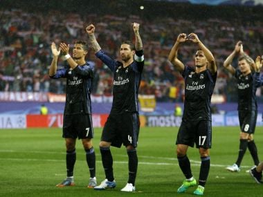 Real Madrid players wave to their fans after progressing to the Champions League final. AP