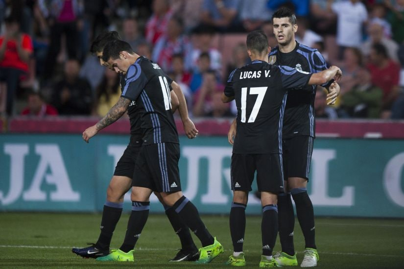 Real Madrid's Alvaro Morata, right, celebrates his second goal against Granada with teammates. AP