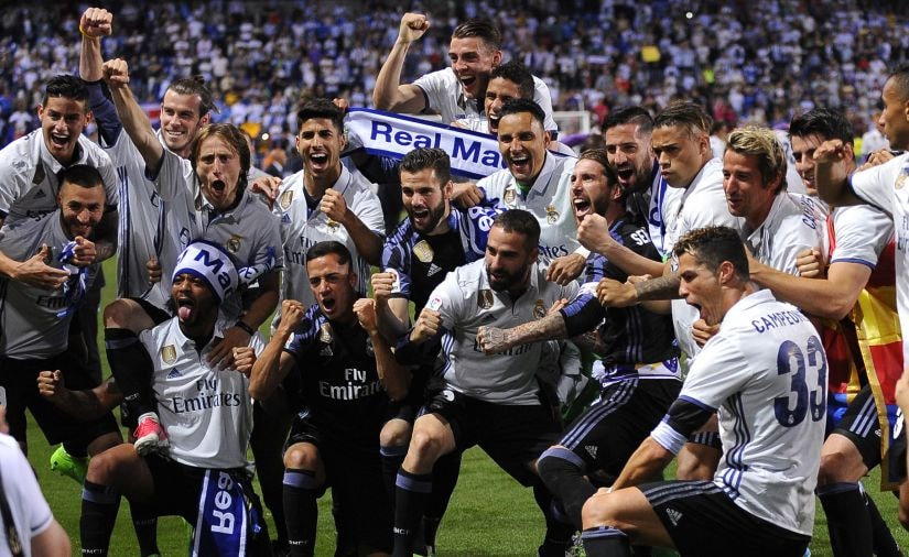 Real Madrid's players celebrate winning the Spanish league for the first time in five years. AP