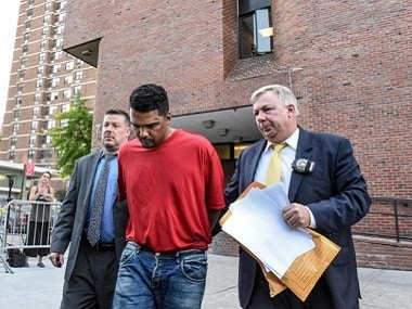 Richard Rojas escorted away by New York police after the accident. Reuters