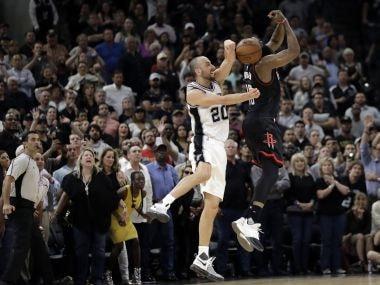 San Antonio Spurs' Manu Ginobili (20) blocks Houston Rockets' James Harden three-point shot attempt. AP