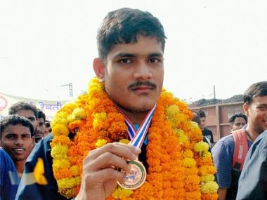 Allahabad: Javelin throwers Rohit Yadav (left) and Avinash Yadav(right) who won silver and bronze, respectively, at the 2nd Asian Youth Athletics Championship at Bangkok, being welcomed on their arrival at Allahabad Railway station on Thursday. PTI Photo (PTI5_25_2017_000066B)