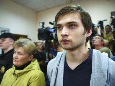 Russian blogger Ruslan Sokolovsky and his mother Yelena Chingina, left, listen to a sentence in a court in Yekaterinburg, Russia, on Thursday. AP