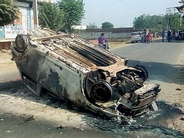 A damaged car after a clash  in Saharanpur. PTI