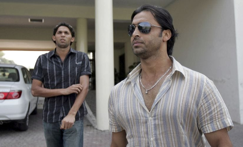 File image of Pakistan's fast bowlers Shoaib Akhtar (R) and Mohammad Asif leaving the PCB head office after facing the three-member Anti-Doping Tribunal. Reuters