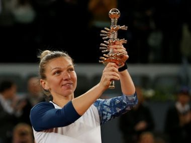 Simona Halep holds the trophy after her victory over Kristina Mladenovic. Reuters