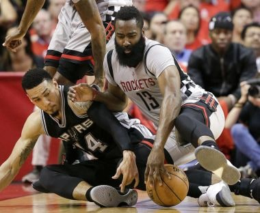 Houston Rockets' James Harden (right) and San Antonio Spurs' Danny Green chase a loose ball. AP