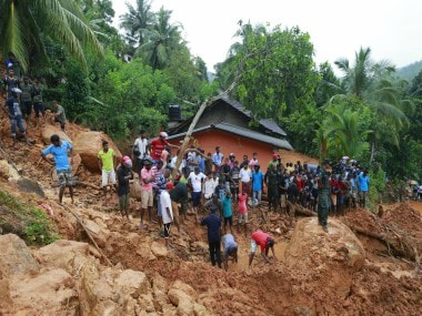 Military tries to rescue people at the site of a landslide in Sri Lanka. AP