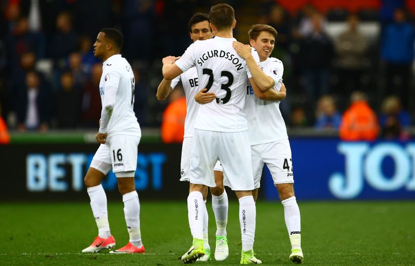 Swansea players celebrate on the pitch after their win over Everton at The Liberty Stadium. AFP
