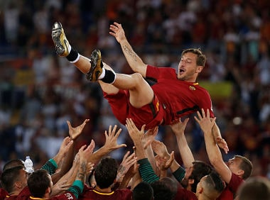 Celebrations galore as Francesco Totti is thrown into the air by team mates after his last game. Reuters