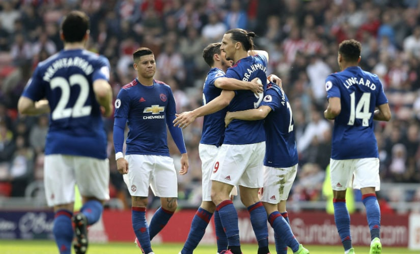 Manchester United players celebrate their win over Middlesbrough. AFP