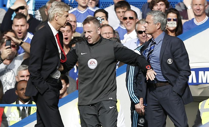 Jose Mourinho (right) and Arsene Wenger. AFP