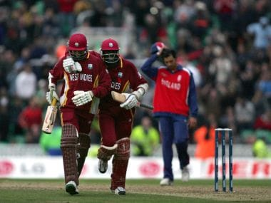 Ian Bradshaw (L) and Courtney Browne of West Indies run off the pitch after scoring the winning runs against England in 2004 Champions Trophy final. AFP