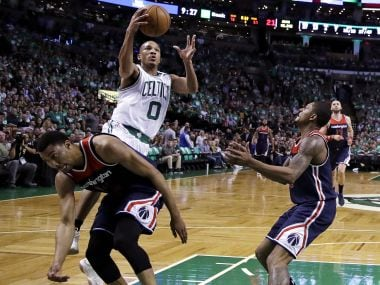 Boston Celtics guard Avery Bradley (0) drives to the basket against the Washington Wizards. AP