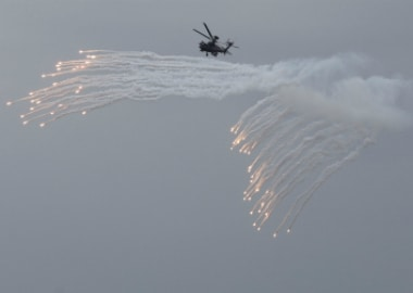AH-64E Apache attack helicopters releases flares during annual Han Kuang military drill in Penghu, Taiwan. Reuters