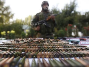 An Indian Army soldier stands behind a display of seized arms and ammunition at a garrison in Srinagar (Representative image) Reuters.