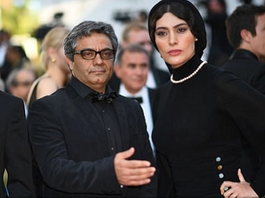 Iranian actor Reza Akhlaghirad, Iranian director Mohammad Rasoulof and Iranian actress Soudabeh Beizaee arrive on May 27, 2017 for the Un Certain Regard prize ceremony at the 70th edition of the Cannes Film Festival in Cannes, southern France. (AFP photo)