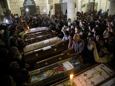 Relatives of the Coptic Christians who were killed during the attack surround their coffins. Getty Images