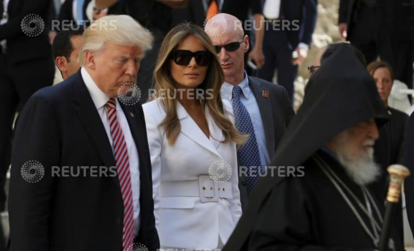 US President Donald Trump and Melania Trump make their way to the Church of the Holy Sepulchre in Jerusalem's Old City. Reuters
