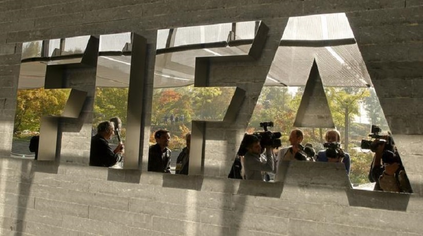 Journalists are reflected in a logo at the FIFA headquarters after a meeting of the executive committee in Zurich, in a file photo. REUTERS/Arnd Wiegmann