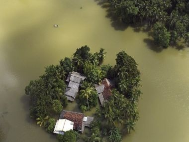 Photo released by Sri Lanka Air Force shows houses submerged in flood waters. AP/PTI