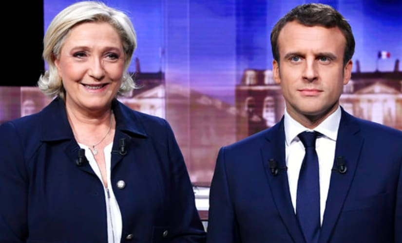 French presidential election candidates Marine Le Pen (left) and Emmanuel Macron. AP