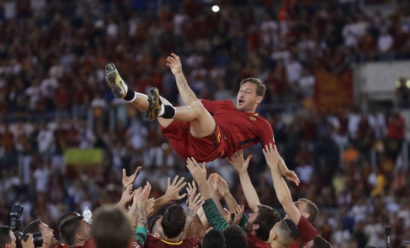 Francesco Totti is tossed in the air by his Roma teammates on Sunday after his final appearance for the club. AP Photo
