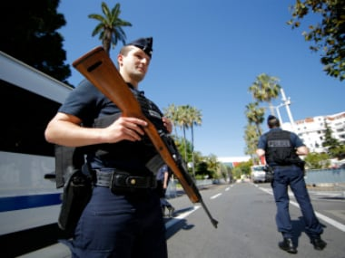 French police stands guard near the Festival Palace  as part of security measures for the opening ceremony in Cannes film festival. Reuters