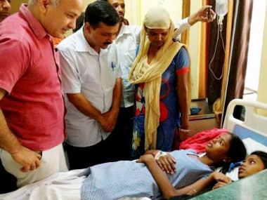 Arvind Kejriwal with Manish Sisodia visit victims of gas leak at a hospital in New Delhi on Saturday. PTI