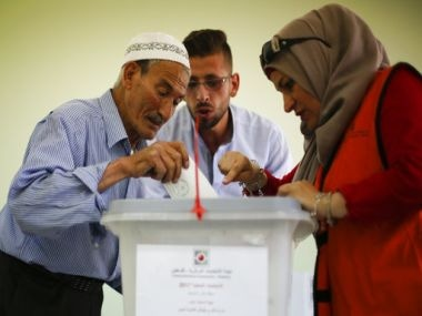 A Palestinian casts his vote at a polling station in the West Bank city of Nablus on Saturday. PTI