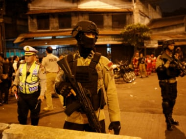 Indonesia police personnel at blast site in Jakarta. Reuters