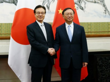 Japanese national security council chief Shotaro Yachi (L) with Chinese State Councillor Yang Jiechi ahead of a meeting in Beijing, China. Reuters