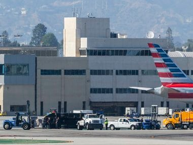 An airport utility truck is seen overturned after an Aeromexico flight clipped the truck, flipping it over, shortly after landing at Los Angeles International Airport. AP
