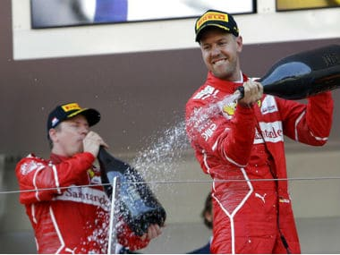 Kimi Raikonne and Sebastian Vettel after winning the Monaco Grand Prix. AP