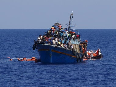 File image of migrants on an overloaded boat during a rescue operation off the coast of Libya. Reuters