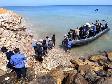 Illegal migrants from Africa arrive on shore after being rescued by Libyan coast guards. Getty Images
