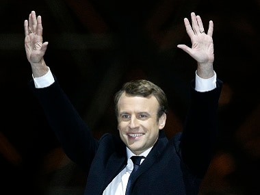 French President-elect Emmanuel Macron gestures during a victory celebration outside the Louvre museum in Paris, France, Sunday, May 7, 2017. Speaking to thousands of supporters from the Louvre Museum's courtyard. AP