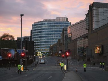 After a night of panic and death, police stands guard outside Manchester Arena. AP