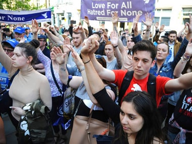 People gesture in solidarity during a vigil at St Ann's Square in central Manchester, England following the concert bombing. AP