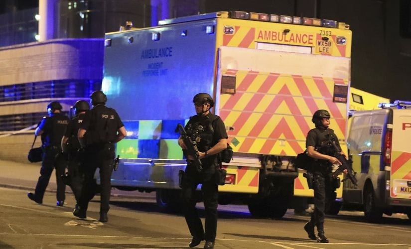 Armed police work at Manchester Arena. AP
